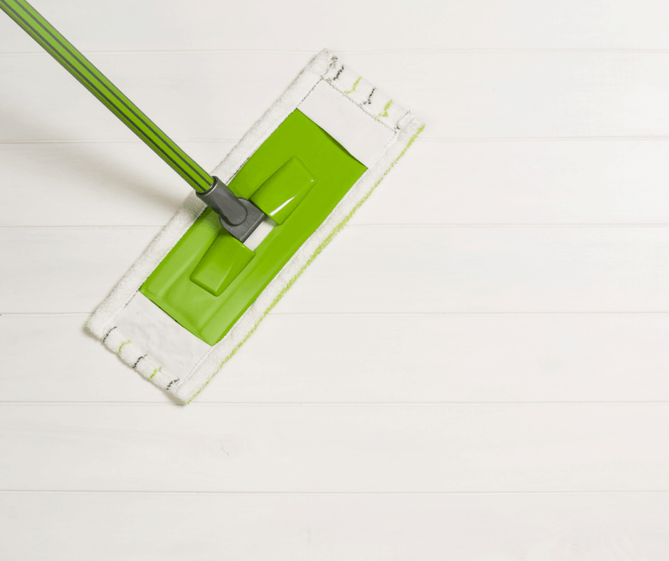 Image of a white and green mop cleaning a white floor